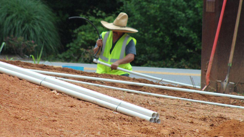 Oasis team member installing an irrigation system