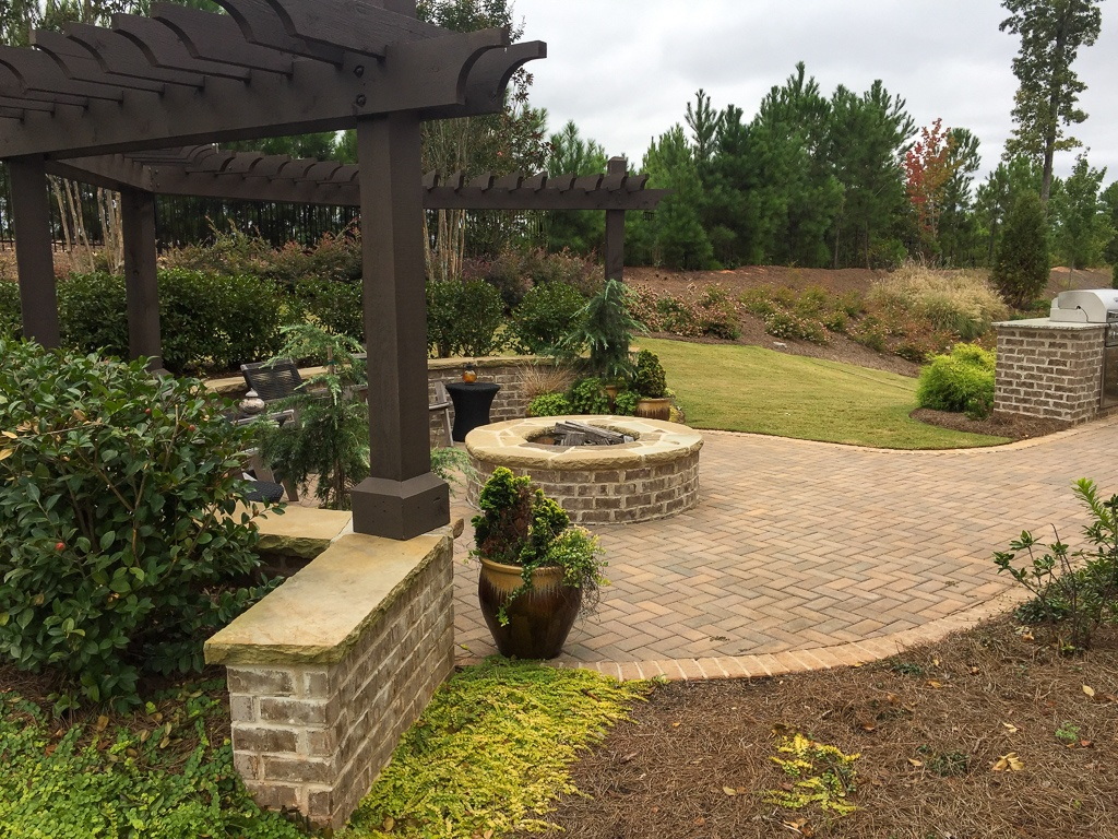 brick paver patio with fire pit and small pergola