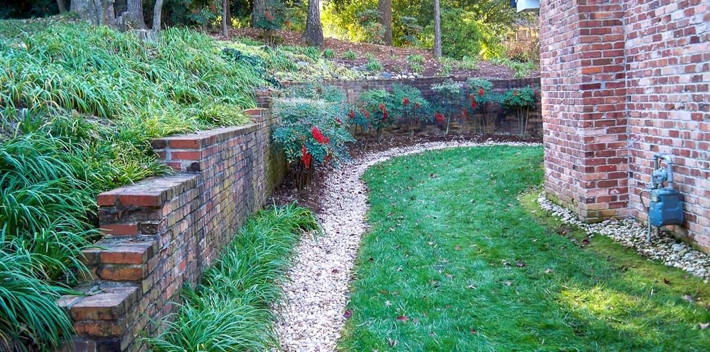 brick retaining wall above french drain