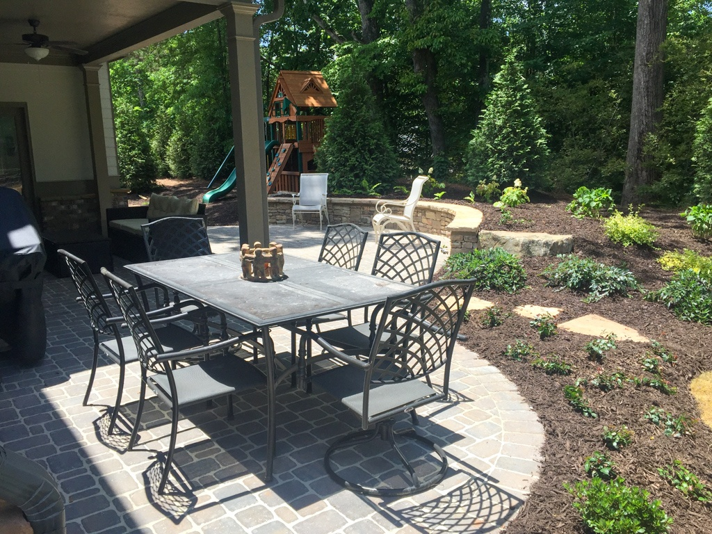Furnished patio with outdoor dining table and play area