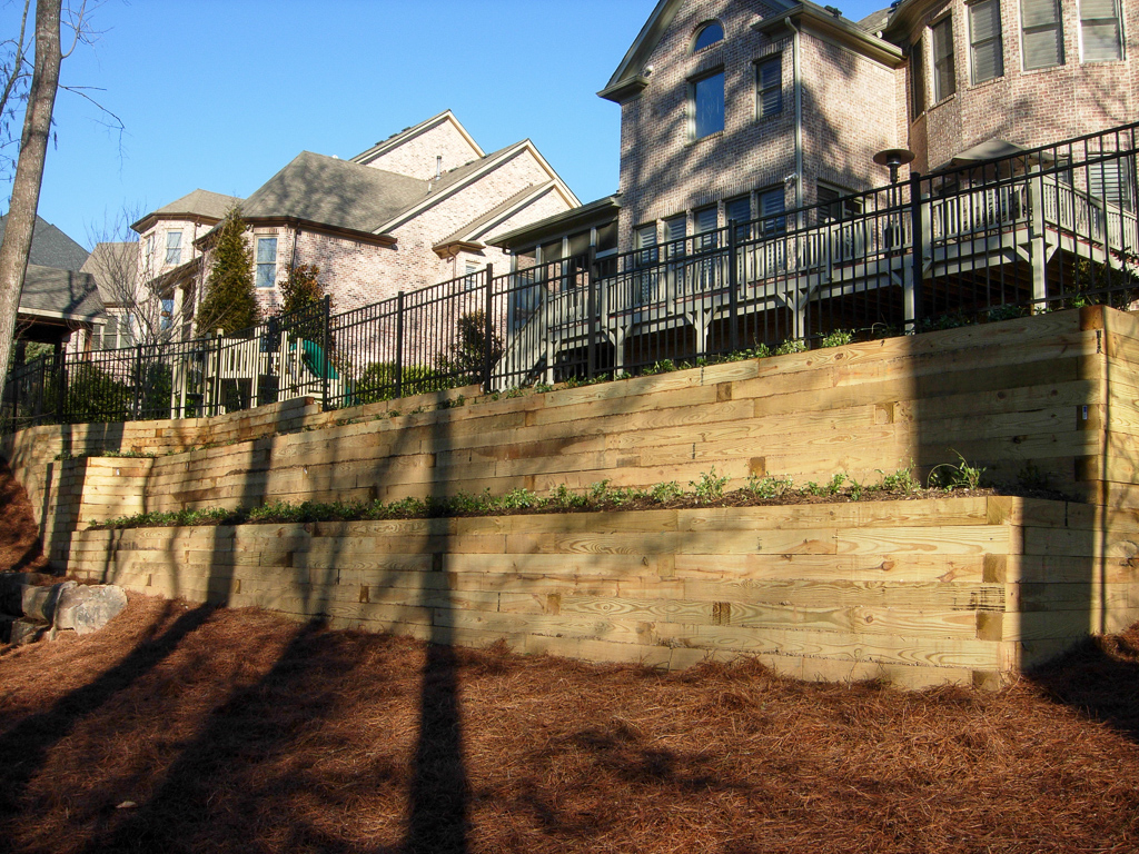 Steep retaining walls behind homes